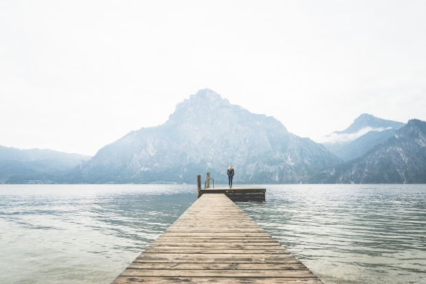 woman-standing-alone-on-a-large-wooden-pier-on-a-lake-picjumbo-com